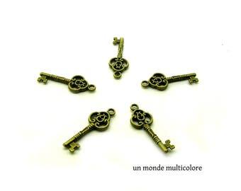 A large baroque style key charm, bronze pendant 28 x 10 mm