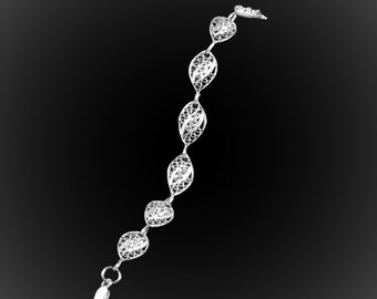 Embroidered silver beads bracelet