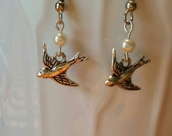 Soaring bird and pearl earrings