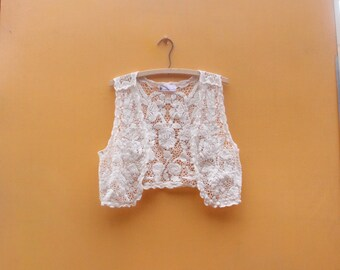 Cute Lace Vest in Women's Estimated Size Small (A cute little white lace free size women's vest with a 30 inch waist.)