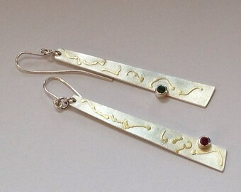 Long, silver, dangle earrings with 18carat gold and tourmalines