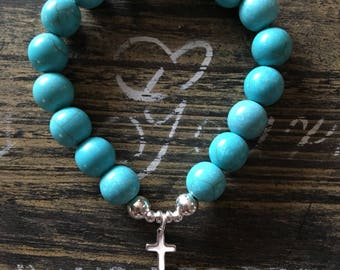 Blue turquoise with sterling silver cross charm
