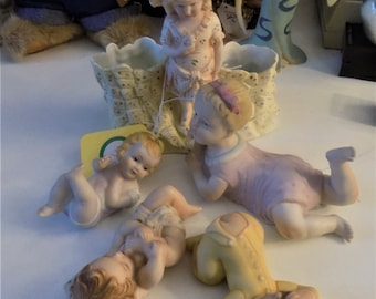 Gertruder Heubach, collection of 5 porcelain swet tPIANO babies