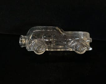 Vintage clear glass candy container sedan car.