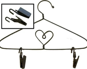 Set of 6 wire clips that go on the bottom of the hangers I have for sale