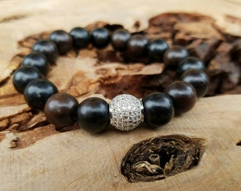 Stackable 12mm Dark Ebony Wood Stretch Bracelet With A Silver Round Micro Pave CZ Bead