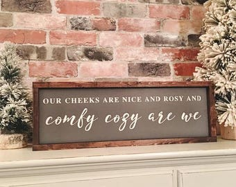 Our cheeks are nice and rosy and comfy cozy are we  painted solid wood sign