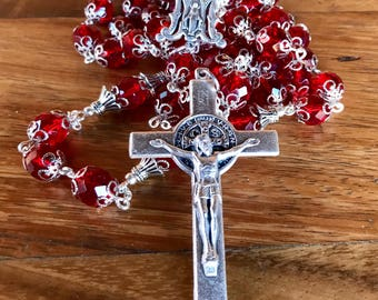 Handmade rosary in red 10mm faceted fire polished glass beads, tibetan silver and St. Benedict crucifix and ornate center station