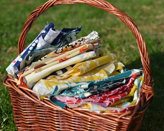 fabric scraps - from various fabrics seen in the shop,  12.5 by 9.5 envelope full! DYI crafts sewing supplies