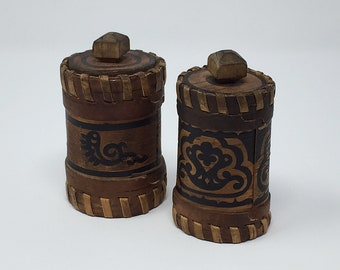 Pair of birch bark boxes with detailed black decoration