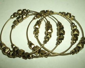 4  BOHO Stackable Floating Bead Brass Color Bangles