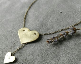 Long necklace with scratched brass pendants.