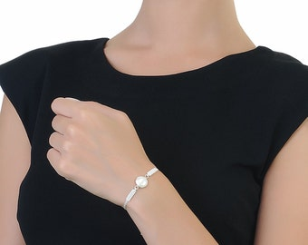 Pearl Bracelet In Silver with white braided adjustable thread
