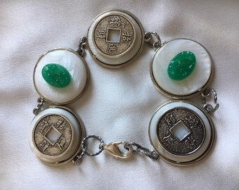 Silver chinese coins and jade like green cabachons on Mother of Pearl- 7 inches