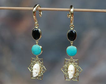 hand carved cow bone skull, with black onyx and turquoise brass hanging styles