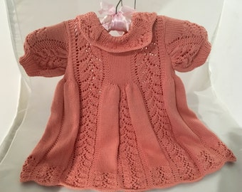 Hand knitted child's dress