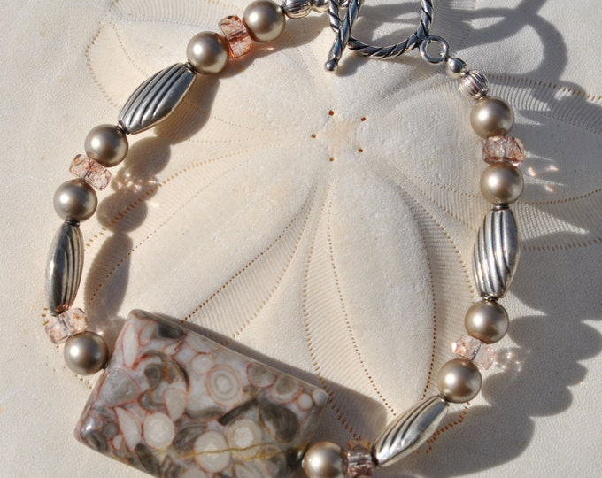 Rectangular Criniod fossil stone bracelet set with barely pink crystals, Bali sterling silver beads and silver pearls.