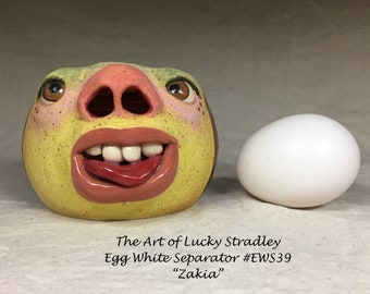 EGG WHITE SEPARATOR - Wheel thrown, hand altered and sculpted, stoneware. Baking is even more eggciting by whites coming from mouth.