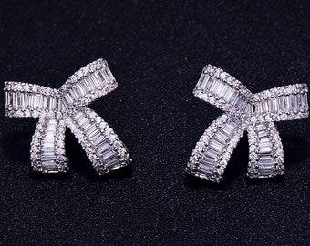 Earrings, stud earrings, pearl earrings, bow earrings, diamond earrings, silver earrings, gold earrings, baguette earrings, diamonds, baguet