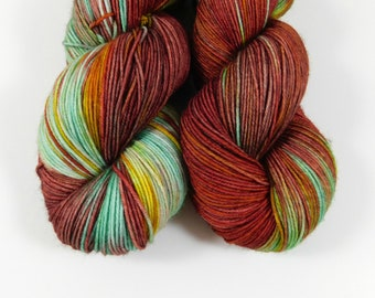 Bazaar, QCC Yarn, Squooshy Cat Yarn, Fingering Weight Yarn, Merino Wool, Green, Yellow, Red