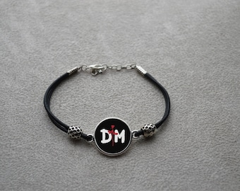 "Wristband leather ""DM"" consisting of a leather link and a silver metal connector"