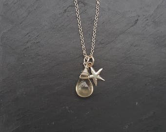 Semi precious, wire wrapped, tear drop shaped scapolite and sterling silver starfish pendant. Subtle pale lemon scapolite gemstone.