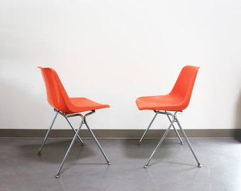 Pair Stacking Robin Day Chairs by John Stuart - Orange