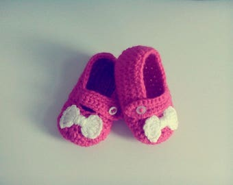 a pair of slippers in wool hand made crochet