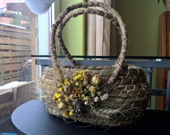 Herbal basket decorated with dry flowers