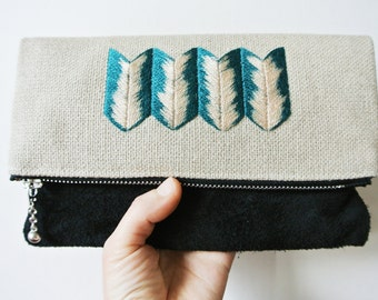Suede and linen fold over zipper clutch with embroidery detail