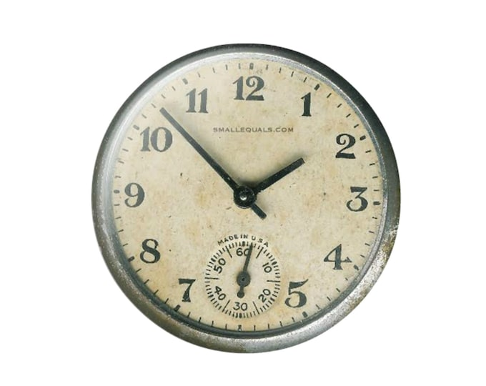 The Ritzi. Decorative watch pinback button. Displays the correct time twice a day.
