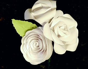 all white paper rose boutonniere corsage lapel pin buttonhole wedding flowers