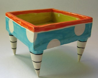 Whimsical pottery Serving Bowl, turquoise, chartreuse & tangerine orange polka-dots, ceramic dish w/ striped beetlejuice feet