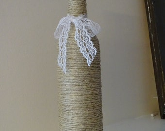 Twine wrapped wine bottle with lace bow