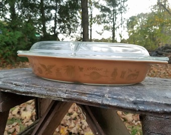 Early American Pyrex divided casserole dish with lid.