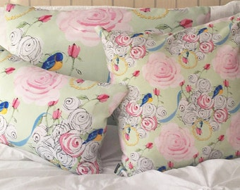 Rectangular Throw Pillow, Bluebirds and Pink Roses on green companion pillow