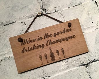 We're in the garden drinking Champagne - Shabby chic style wooden wall plaque/sign. Great alcohol drinking sign for friends and family