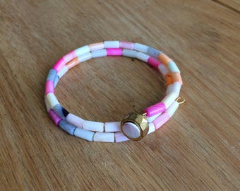 Pink and coral beaded bracelet with button accent