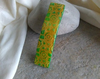 hair clip polymer clay in shades of mustard yellow and Apple green
