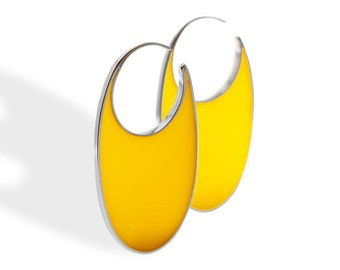 Handmade sterling silver and yellow resin hoop earrings.