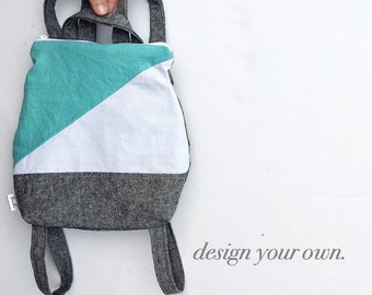 Small backpack purse in color block style. Design your own small handbag. zipper closure. adjustable straps. mini backpack for all ages.