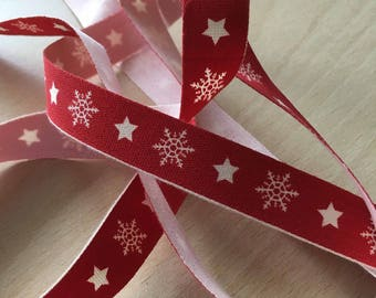 "decorative Ribbon: ""cream Snowflake"" on red background"
