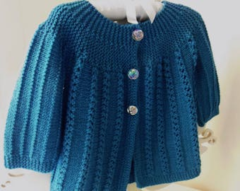 PDF Aussie Swing; One piece knitting pattern for a A Line lacy, short or long sleeve cardigan for babies & toddlers, 2 lace options