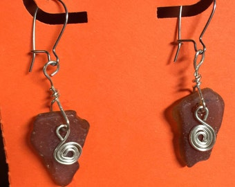 Brown Sea Glass dangle earrings with silver-tone wire.  On surgical steel ear wires.