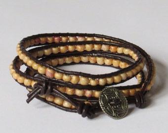 E-1637  Tan and pink beaded wrap bracelet