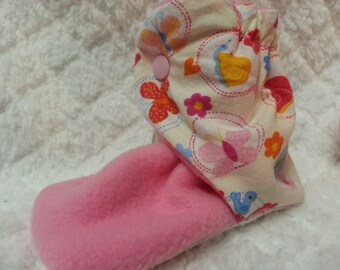 Toddler, 5 inch butterfly cotton and pink fleece baby booties that snap on .