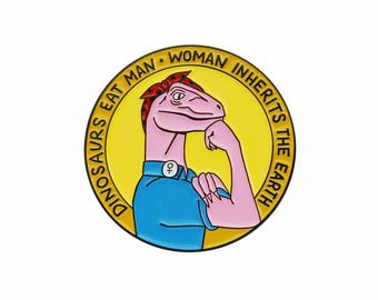 Jurassic Park dinosaurs eat man woman inherits earth enamel lapel pin