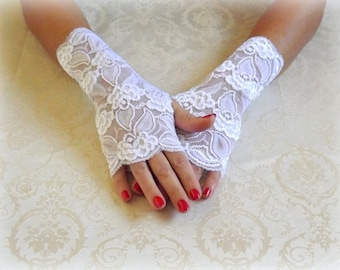 White lace gloves. Fingerless gloves. Bridal gloves. Floral lace mittens. Wedding gloves. Stretch lace gloves. Short gloves.