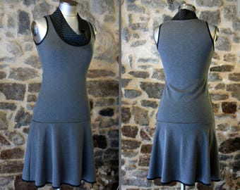 Promo Studio space. Dress gray mouse polka dot black and gray Italian Jersey. Two-tone dress