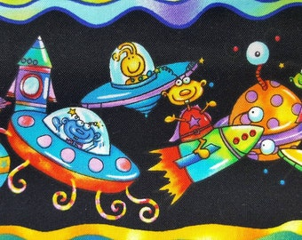 100% cotton Quilting fabric price by the 1/2 yard aliens alien outer space bright colorful goofy funny fun juvenile border print.  Too cute.